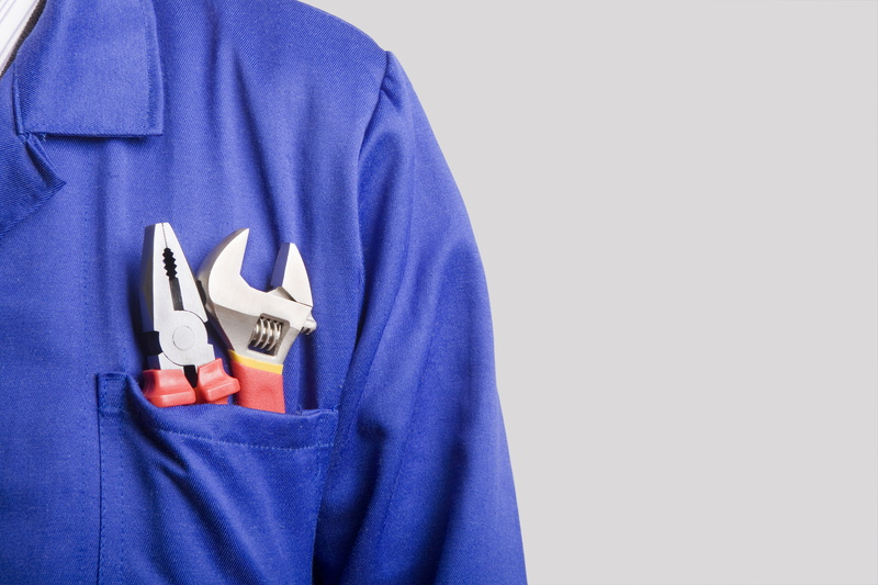 blue-shirt-with-tools-in-pocket